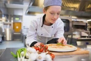 female chef with pizza
